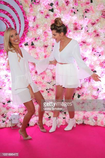 Model Alena Fritz former Gerber and Sarah Nowak wearing the same white dress by Zara during the Hyaluron Party of Dr Niedermaier Regulat at...