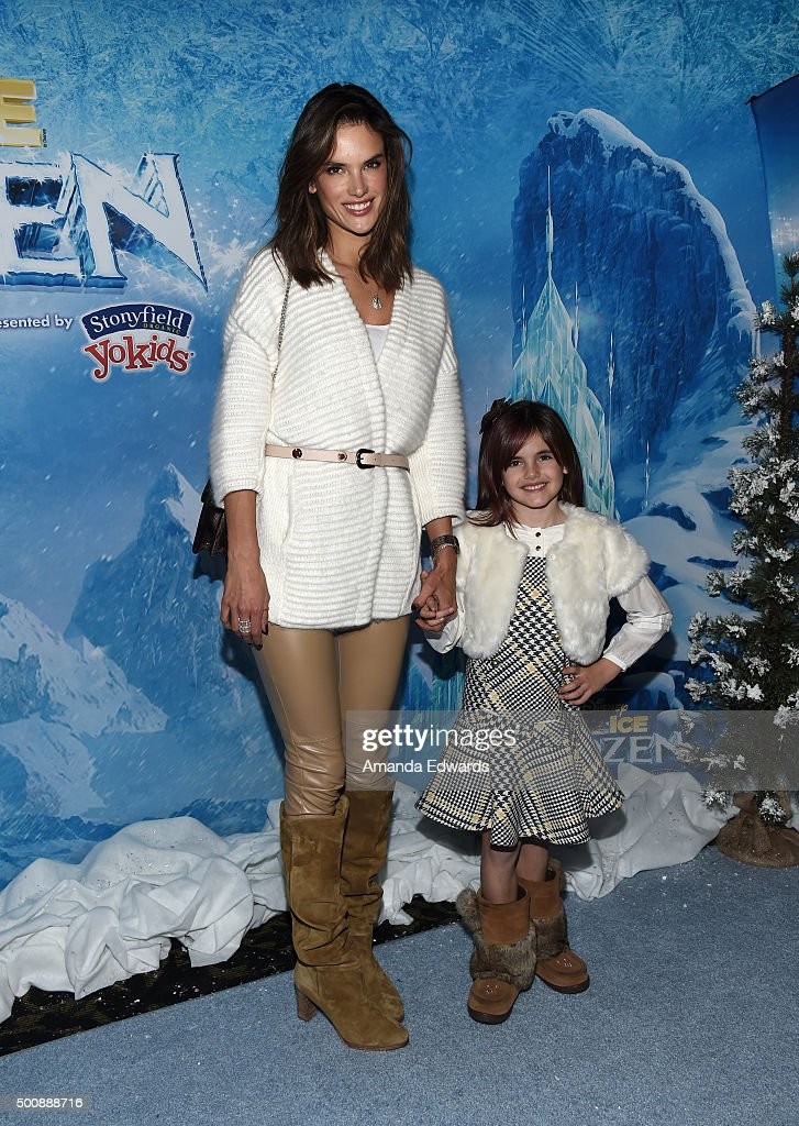 Model Alessandra Ambrosio and her daughter Anja Mazur arrive at the premiere of Disney On Ice's 'Frozen' at Staples Center on December 10, 2015 in Los Angeles, California.