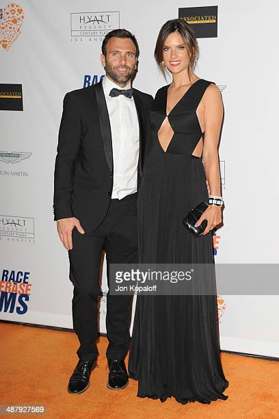Model Alessandra Ambrosio and Jamie Mazur arrive at the 21st Annual Race To Erase MS Gala at the Hyatt Regency Century Plaza on May 2 2014 in Century...
