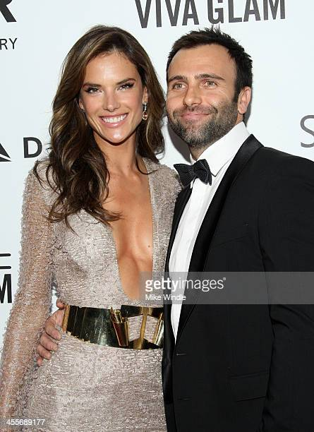Model Alessandra Ambrosio and Jamie Mazur attend the 2013 amfAR Inspiration Gala Los Angeles at Milk Studios on December 12 2013 in Los Angeles...