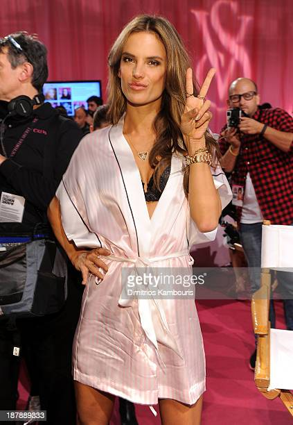 Model Alessandra Ambrosio prepares at the 2013 Victoria's Secret Fashion Show hair and makeup room at Lexington Avenue Armory on November 13 2013 in...