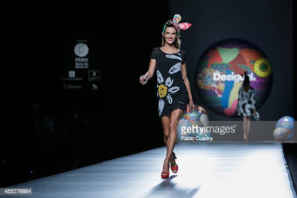 Model Alessandra Ambrosio showcases designs by Desigual on the runway at Desigual show during Mercedes Benz Fashion Week Madrid at Ifema on September...