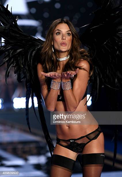Model Alessandra Ambrosio walks the runway during the 2014 Victoria's Secret Fashion Show at Earl's Court Exhibition Centre on December 2 2014 in...