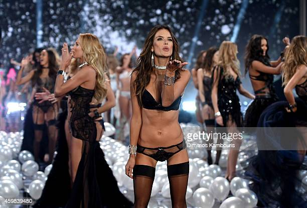 Model Alessandra Ambrosio walks the show finale of the 2014 Victoria's Secret Fashion Show at Earl's Court Exhibition Centre on December 2 2014 in...