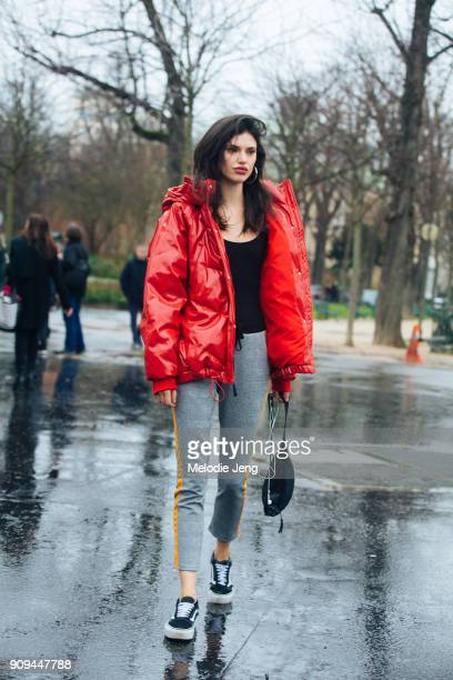 Model Alex Binaris wears a red puffer jacket outside the Chanel show at Grand Palais on January 23 2018 in Paris France