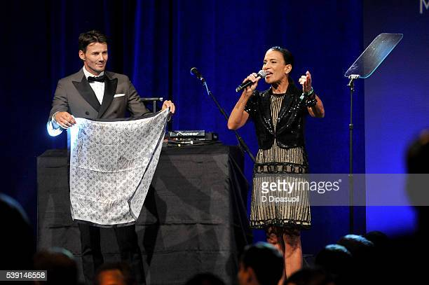 Model Alex Lundqvist and Andrea Fiuczynski speak onstage during the 7th Annual amfAR Inspiration Gala at Skylight at Moynihan Station on June 9 2016...