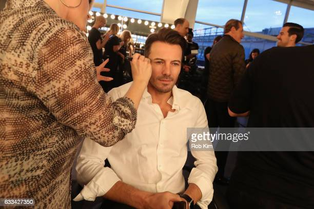 Model Alex Lundqvist prepares backstage at Inaugural Blue Jacket Fashion Show to benefit Prostate Cancer Foundation on February 1 2017 in New York...