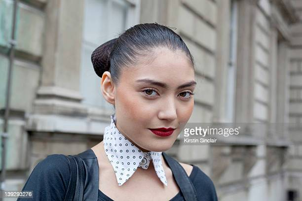 Model Alex Wurfel wearing an Urban Outfitters collar and leather top/dress and cuff made by her Mum at London Fashion week autumn/winter 2012...