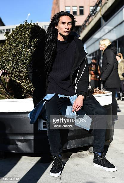 Model Alexander Dominguez is seen outside the Tibi show wearing a Control Sector jacket DKNY sweater and Van sneakers during New York Fashion Week...