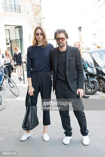 Model Alexandra Agoston wears an Acne sweater Chloe pants and Celine bag with Chris Colls who wears a Rick Owens suit and Court Spring sneakers day 4...