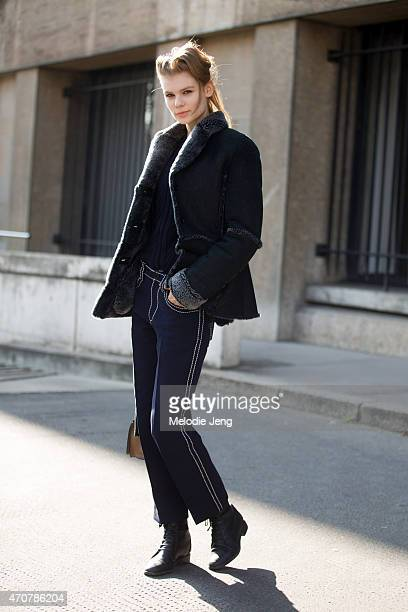 Model Alexandra Elizabeth Ljadov exits Miu Miu show in Miu Miu and Prada on Day 9 of Paris Fashion Week FW15 on March 11 2015 in Paris France