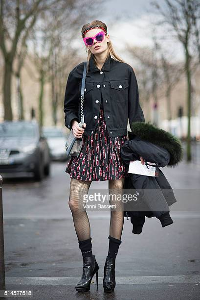 Model Alexandra Elizabeth Ljadov poses after the Miu Miu show at Place de Iena during Paris Fashion Week FW 16/17 on March 9 2016 in Paris France