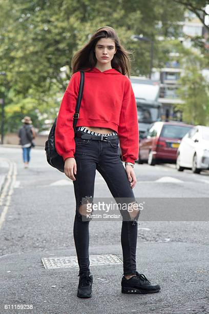 Model Alexandra Micu wears H and M jeans vintage jumper Versus underwear Nike shoes and Pull and Bear backpack on day 3 of London Womens Fashion Week...