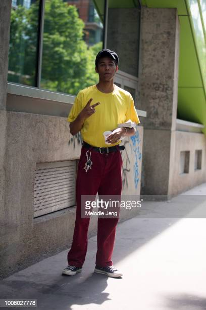 Model Alexandre at Tomorrow Is Another Day agency wears a newboy cap yellow tshirt red pants black converse and throws a peace sign after the AMI...