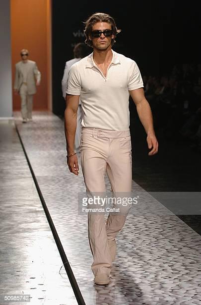 Model Alexandre Verga walks the runway at the Ricardo Almeida 2005 Spring/Summer collection during the Sao Paulo Fashion Week June 16 2004 in Sao...