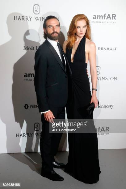 Model Alexina Graham and hairstylist John Nollet poses during a photocall as part of a dinner organized by the foundation for AIDS research amfAR on...