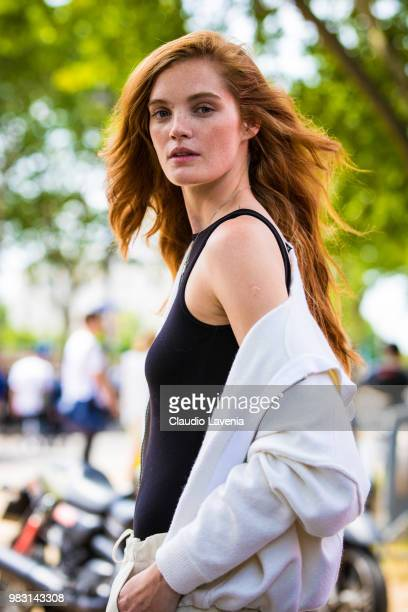 Model Alexina Graham wearing black top and white sweater is seen in the streets of Paris after the Balmain show during Paris Men's Fashion Week...