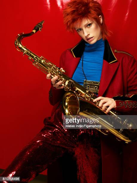 Model Alice Cornish poses as David Bowie at a fashion shoot for Madame Figaro on May 10 2017 in Paris France Coat top pants necklace Saxophone CREDIT...