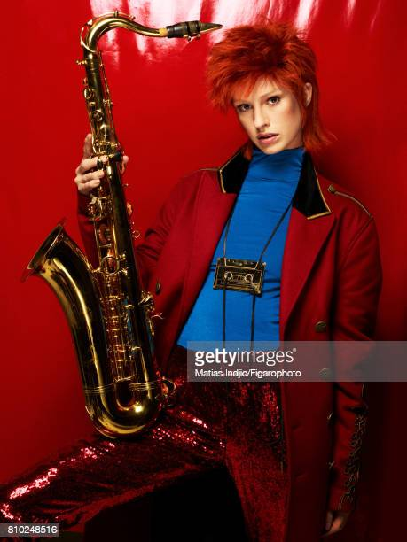 Model Alice Cornish poses as David Bowie at a fashion shoot for Madame Figaro on May 10 2017 in Paris France Coat top pants necklace Saxophone...
