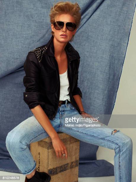 Model poses as George Michael at a fashion shoot for Madame Figaro on May 10 2017 in Paris France Jacket tank top jeans sunglasses earring belt ring...