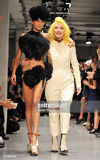 Model Alice Dellal and designer Pam Hogg walk down the runway during the Pam Hogg Spring/Summer 2011 fashion show at the On/Off venue on September 19...