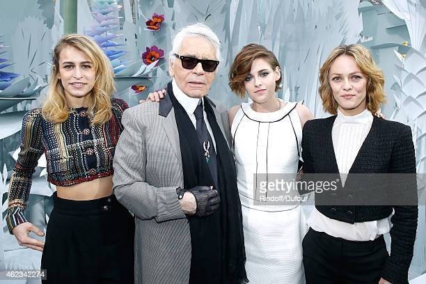 Model Alice Dellal Fashion Designer Karl Lagerfeld Actresses Kristen Stewart and Vanessa Paradis pose after the Chanel show as part of Paris Fashion...