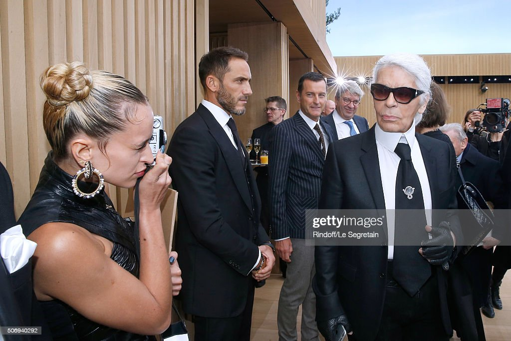 Model Alice Dellal takes Stylist Karl Lagerfeld in pictures after the Chanel Spring Summer 2016 show as part of Paris Fashion Week on January 26, 2016 in Paris, France.