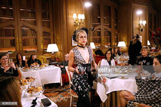 Model Alice Dellal walks the Runway during the Chanel Collection des Metiers d'Art 2016/17 Paris Cosmopolite Show at Hotel Ritz on December 6 2016 in...