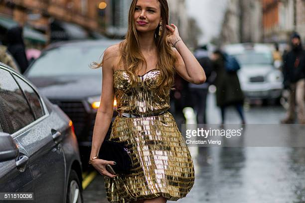 Model Alicia Rountree wearing a golden dress seen outside Julien Macdonald during London Fashion Week Autumn/Winter 2016/17 on February 20 2016 in...