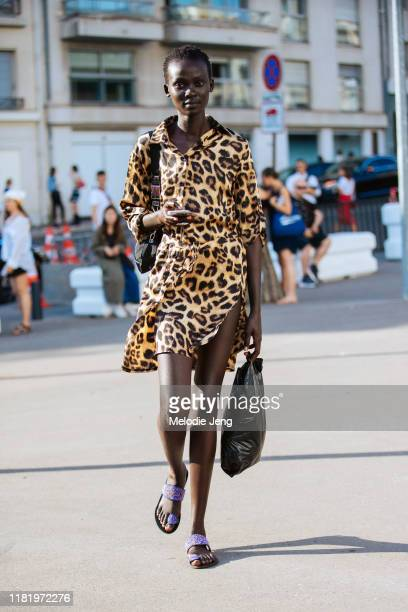 Model Aliet Sarah wears a cheetah print dress and purple beaded sandals after the Acne Studios Spring/Summer 2020 show on June 30, 2019 in Paris,...