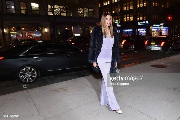 Model Alina Baikova arrives at the 2017 amfAR generationCURE Holiday Party on December 1 2017 in New York City