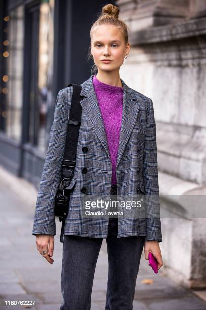 Model Alina Egorova wearing a purple sweater grey jeans and grey checked blazer is seen outside the Beautiful People show during Paris Fashion Week...