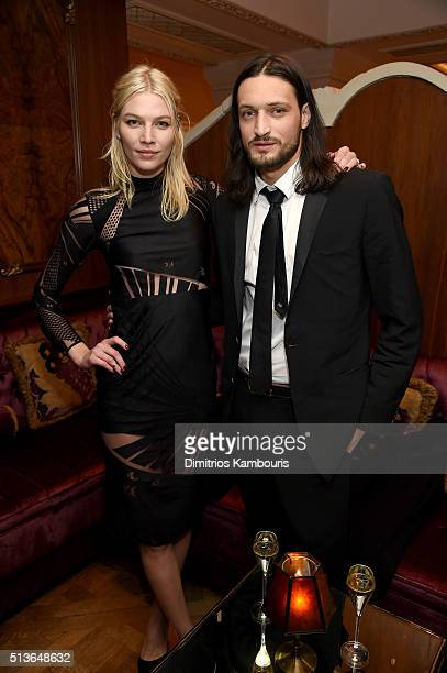 Model Aline Weber and a guest attend 'Battle at Versailles' New York Premiere at Paris Theater on March 3 2016 in New York City