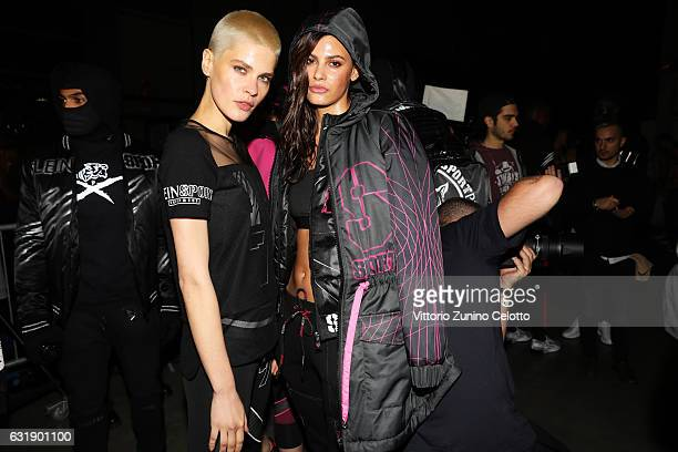 Model Alisar Ailabouni and another model pose backstage ahead of the Plein Sport show during Milan Men's Fashion Week Fall/Winter 2017/18 on January...