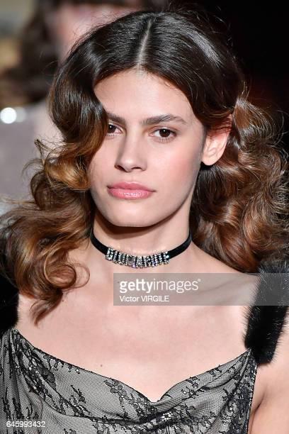 Model Alisar Ailabouni walks the runway at the Blumarine Ready to Wear fashion show during Milan Fashion Week Fall/Winter 2017/18 on February 25 2017...