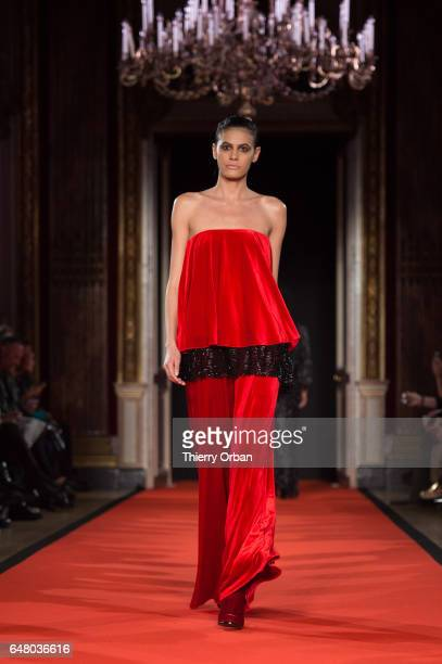 Model Alisar Ailabouni walks the runway during the Talbot Runholf show as part of the Paris Fashion Week Womenswear Fall/Winter 2017/2018 on March 4...