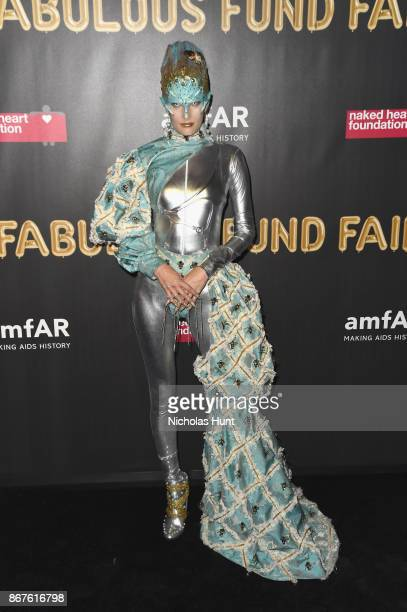Model Alla Kostromichova attends the 2017 amfAR The Naked Heart Foundation Fabulous Fund Fair at Skylight Clarkson Sq on October 28 2017 in New York...