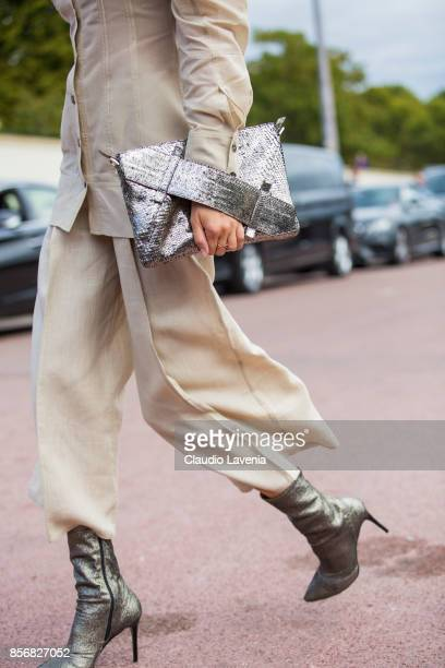 Model Alla Kostromichova fashion detail is seen before the Hermes show during Paris Fashion Week Womenswear SS18 on October 2 2017 in Paris France
