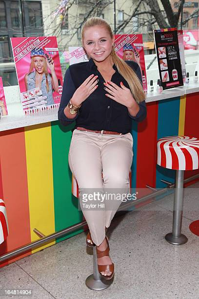 Model Alli Simpson attends the Alli Simpson imPRESS Signature Nail Series Launch Event at Dylan's Candy Bar on March 28 2013 in New York New York