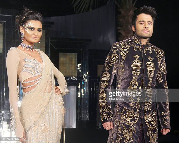 A model along with Jackie Bhagnani walks the ramp for designer Falguni Shane Peacock during Aamby Valley India Bridal Week 2011 fashion show held in...