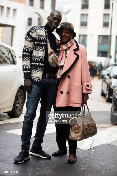 Model Alpha Dia and a friend after the Ferragamo show during Milan Fashion Week Fall/Winter 2018/19 on February 24 2018 in Milan Italy Alpha wears a...