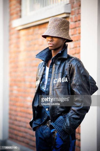 Model Alton Mason wearing a black leather Balenciaga jacket blue printed jeans and Fendi hat is seen outside the Fendi show during the Milan Men's...