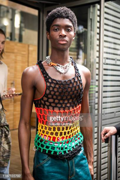 Model Alton Mason wearing a crochet colorful top and metallic green pants is seen outside OffWhite fashion show on Day 2 during the Paris Fashion...