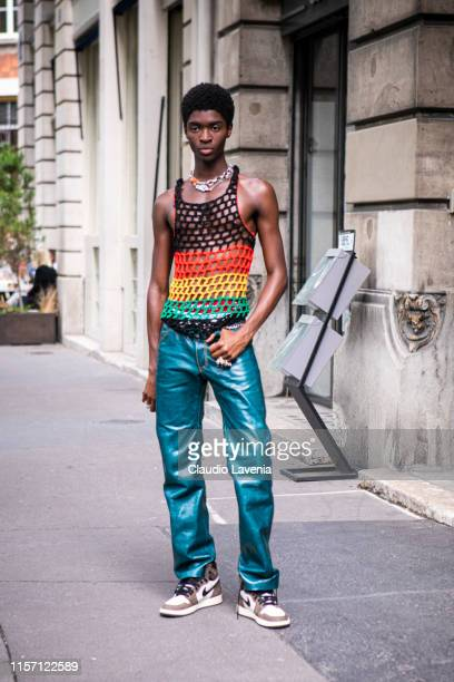 Model Alton Mason wearing a crochet colorful top metallic green pants and Nike sneakers is seen outside OffWhite fashion show on Day 2 during the...