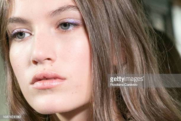 Model Altyn Simpson, make up detail, is seen backstage ahead of the Blumarine show during Milan Fashion Week Spring/Summer 2019 on September 21, 2018...