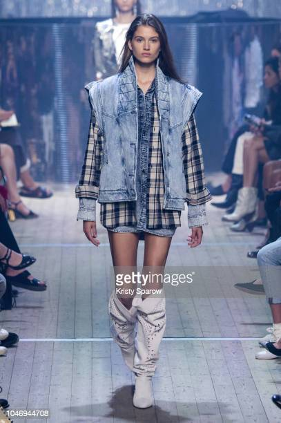 Model Altyn Simpson walks the runway during the Isabel Marant show as part of Paris Fashion Week Womenswear Spring/Summer 2019 on September 27 2018...