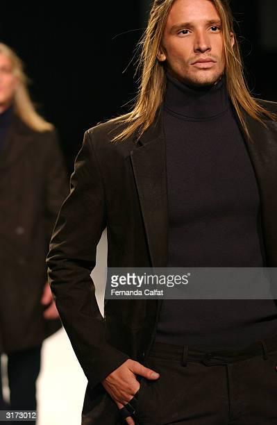 Model Alvaro Jacomossi presents a creation by designer Ricardo Almeida as part of the Winter 2004 Sao Paulo Fashion Week in Sao Paulo Brazil 28...
