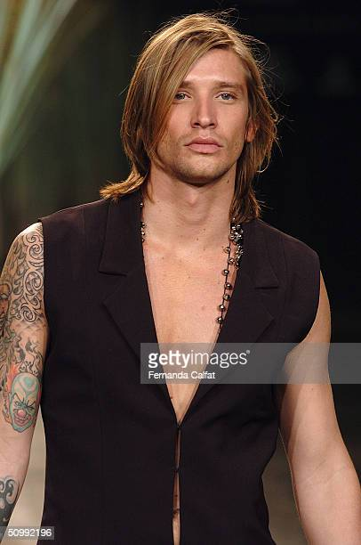 Model Alvaro Jacomossi walks the runway at the Eduardo Suppes 2005 Spring/Summer collection during the Sao Paulo Fashion Week June 17 2004 in Sao...