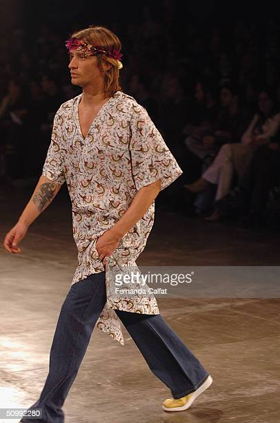Model Alvaro Jacomossi walks the runway at the Mario Queiroz 2005 Spring/Summer collection during the Sao Paulo Fashion Week June 17 2004 in Sao...