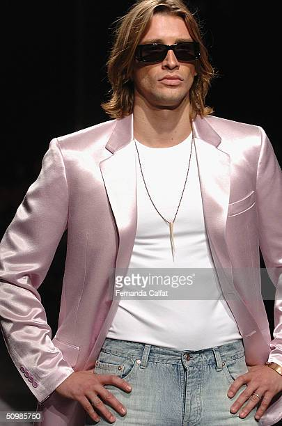 Model Alvaro Jacomossi walks the runway at the Ricardo Almeida 2005 Spring/Summer collection during the Sao Paulo Fashion Week June 16 2004 in Sao...
